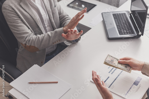 Fotografija Disgusted male employee refusing to take bribe