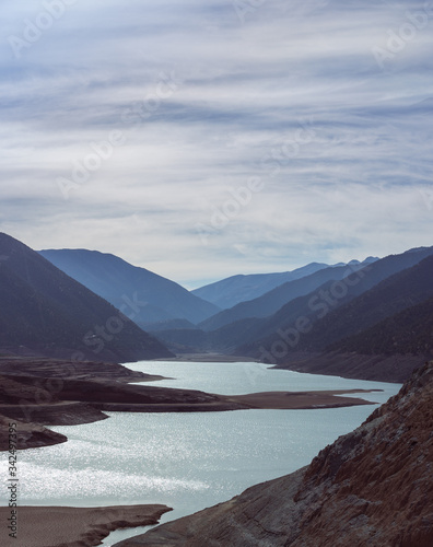 Oued N'fis river reservoir near berber village Ouirgnane in High Atlas Mountains, Morocco, Dry winter in Toubkal National Park Wallpaper Mural