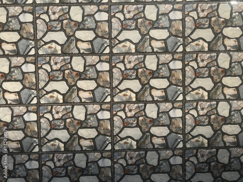 Photo Compound wall tiles with printed design of small stones in random aggregates sty