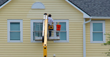 Worker Painting A House