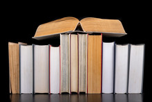 A Stack Of Books On The Desk. ...