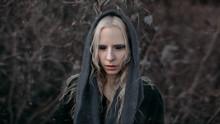 Portrait Of An Albino Girl In A Scarf In The Winter Season.