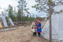 Two Female Saami, Sami In National Dress, Saami Village On The Kola Peninsula, Russia.
