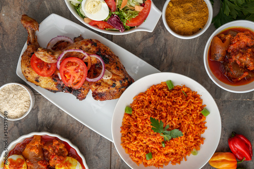 African dishes healthy lifestyle dish with plantain rice and Jollof Rice Tablou Canvas