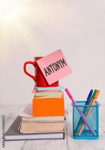 Photo Writing note showing Antonym