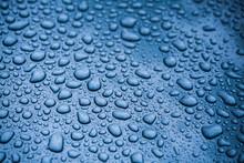 Full Frame Shot Of Raindrops On Blue Background