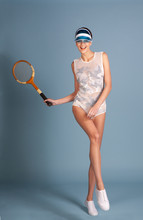 Female Tennis Woman With Vintage Wooden Racquet Isolated On Blue Background