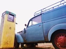 Vintage Car By Abandoned Fuel Pump