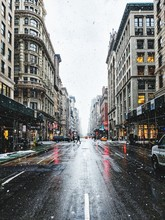 Wet Street In City During Snowfall