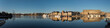 A sunny early day in Stockholm, view over piers with boats and birds at the old town Gamla Stan district