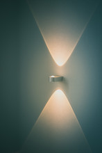 Close-up Of Illuminated Light Sconce On Wall