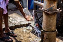 Man Using Water Bottle His Han...