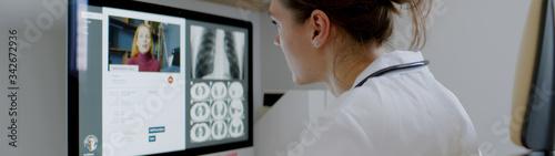 Obraz Caucasian female doctor delivering telemedicine consultation to a patient. Telehealth, telemedicine, remote consultation service. Coronavirus, COVID-19 - fototapety do salonu
