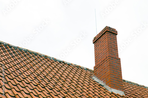 Photo Brick chimney building, house roof