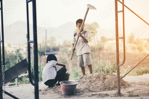 Photo Children are forced to work in construction areas