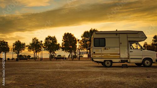 Camper car on beach at evening Canvas Print