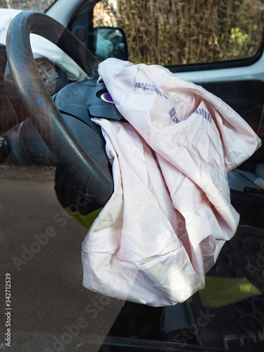 Exploded airbag in steering wheel. Used airbags Canvas Print