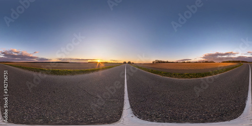 Papel de parede Full spherical seamless hdri panorama 360 degrees angle view on no traffic asphalt road among fields in evening  before sunset with clear sky