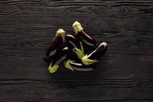 Fresh Eggplants On Wooden Table