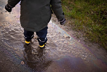A Child In Waterproof Yellow R...