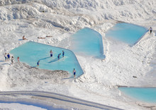 Pamukkale, Turkey - One Of The Most Famous Attractions Of Turkey, And A Unesco World Heritage Site, Pamukkale Is Visited By Millions Each Year. Here In Particular The White Travertine Terraces