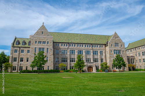 Fototapeta Lyons Hall with Collegiate Gothic style at the quad in Boston College