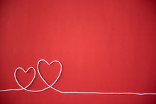 Close-up Of Heart Shapes On Red Background
