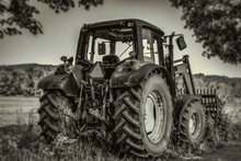 Farm Tractor Agricultural Machine In Sepia