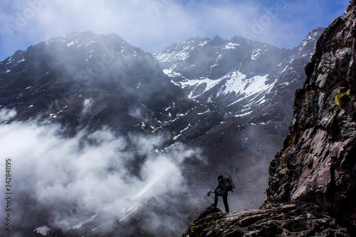 spectacular panorama of a mountaineer hiking in the great atlas of morocco with Canvas Print
