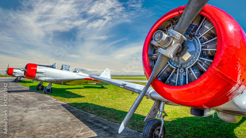 historical aircraft on an airfield Canvas Print