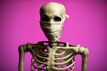 A Skeleton Wearing A Cloth Med...