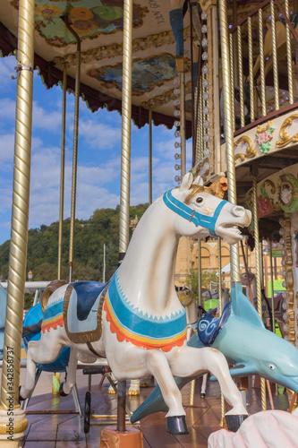 Valokuvatapetti Colorful merry-go-round with horse figure