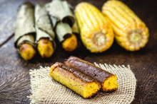 Broa Made With Corn And Wrapped In Banana Leaf. Corn Bread Made For The June And July Parties In Brazil. Brazilian Cuisine.
