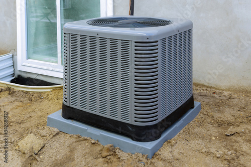 Cuadros en Lienzo Air conditioning system outside installation on of the house.