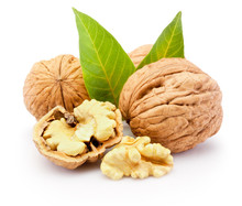 Kernel And Whole Walnuts With Leaves Isolated On White Background