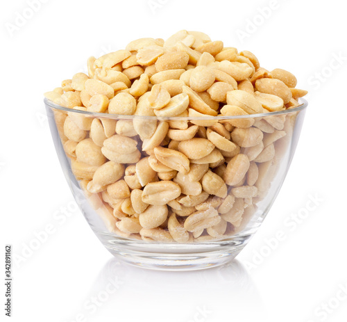 Fotografering Roasted salted peanuts in glass bowl isolated on a white background
