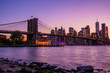 Magical evening purple sunset view of the Brooklyn bridge from the Brooklyn park