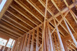 canvas print picture - Framing beam of private residential house on wooden frame under construction