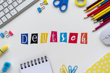 Word DEUTSCH Made With Colorful Letters On A White Table With Keyboard And School Stationery. Top View Learn A New Language At Home During COVID-19 Quarantine