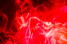 Close-up Of Red Smoke Against Black Background