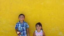 Cute Siblings Standing Against...