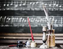 Old-fashioned Writing Equipment With Candlestick Holder On Table