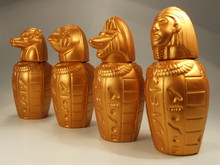 Close-up Of Canopic Jars Against White Background