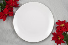 White Round Plate Mockup With Festive Poinsettias