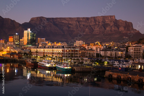 Fototapeta View of Table Mountain at dawn from waterfront of Cape Town