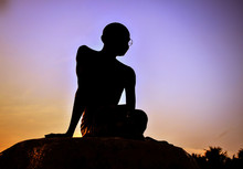 Silhouette Of Mahatma Gandhi Statue Against Sky