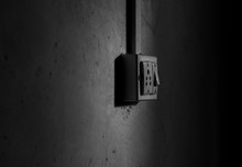 Outlet With Light Switch On Old Wall