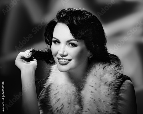 Vintage portrait of attractive woman wearing fur coat and posing as hollywood st Canvas Print