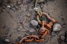 High Angle View Of Rusty Chain...