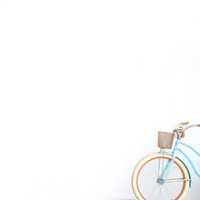 Bicycle Parked Against White Wall